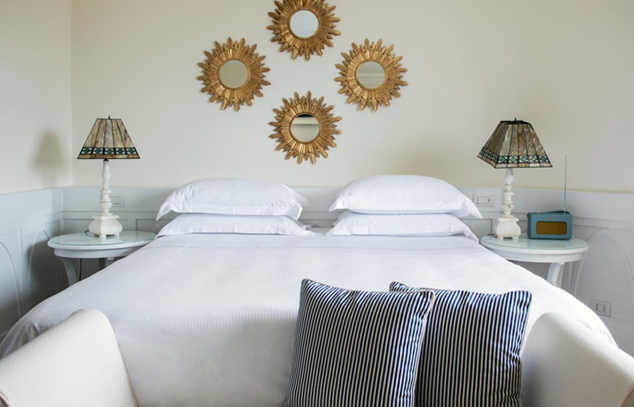 Rivolta Carmignani progetti hotel Mezzatorre biancheria letto